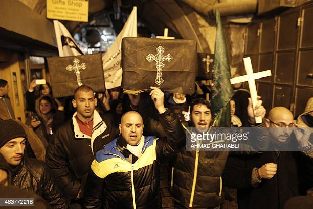Christians take part in a symbolic funeral in Jerusalem's Old City on February 18 for the 21 Egyptian Coptic Christians beheaded by the Islamic State...