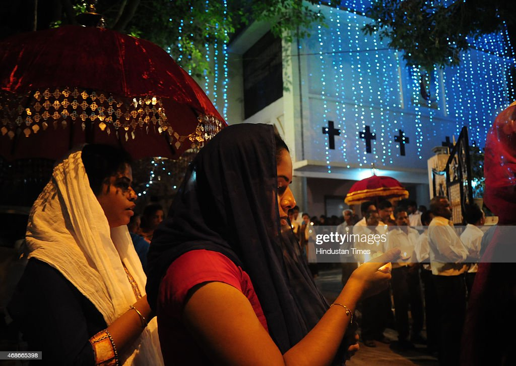 Christians taking part in Easter procession taken out from St Thomas church on April 5 2015 in Bhopal India Easter is a festival and holiday...