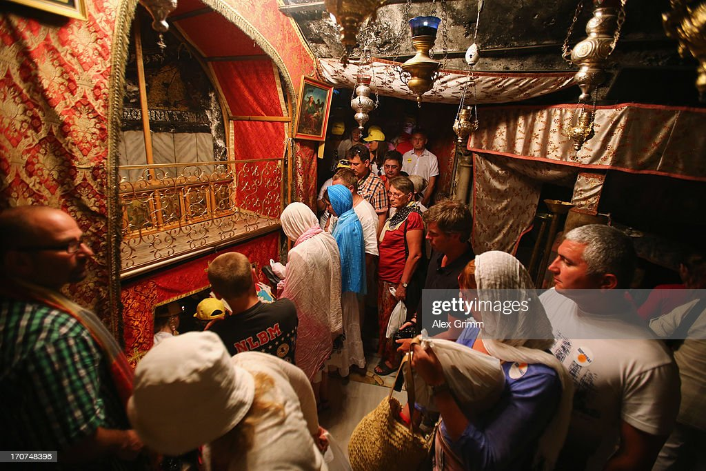 Christians wait in a line to pray at the altar in the Grotto of the church of the Nativity, the spot believed to be the birth place of Jesus Christ, on June 16, 2013 in Bethlehem, West Bank.