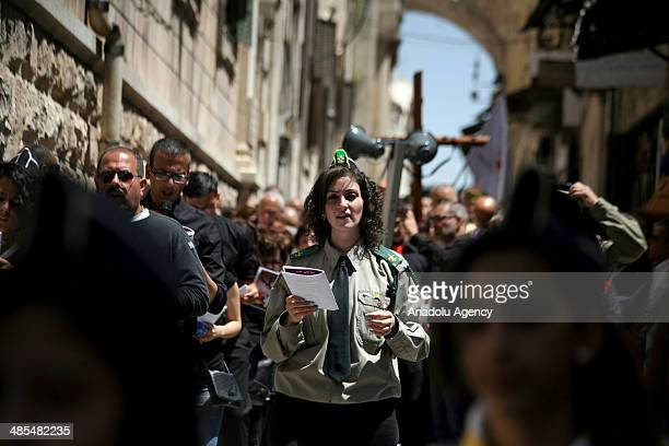 Christians walk along the Via Dolorosa to commemorate the crucifixion and death of Jesus Christ on the hill of Golgotha during the Good Friday in...