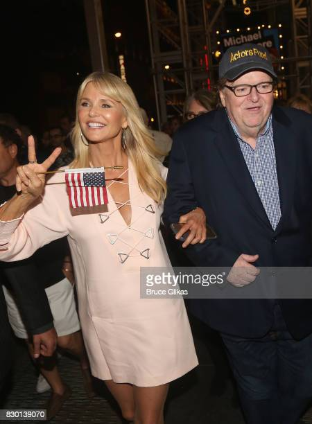 Christie Brinkley and Michael Moore walk in a parade of celebration to the opening night party for 'Michael Moore 'The Terms Of My Surrender' on...