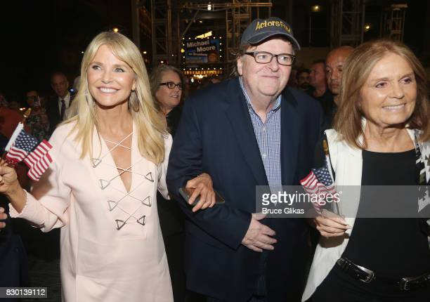 Christie Brinkley Michael Moore and Gloria Steinem walk in a parade of celebration to the opening night party for 'Michael Moore 'The Terms Of My...
