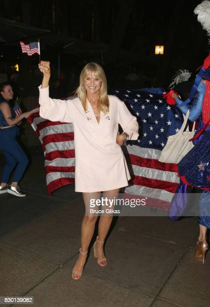 Christie Brinkley poses during a parade of celebration to the opening night party for 'Michael Moore 'The Terms Of My Surrender' on Broadway at The...