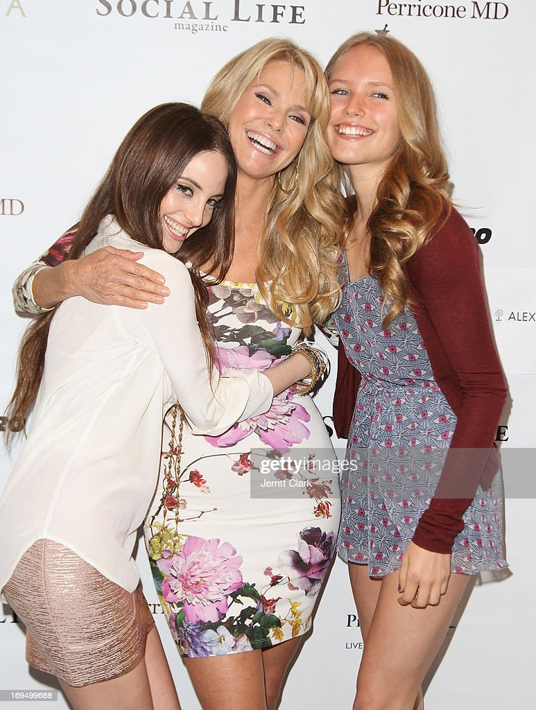 <a gi-track='captionPersonalityLinkClicked' href=/galleries/search?phrase=Christie+Brinkley&family=editorial&specificpeople=204151 ng-click='$event.stopPropagation()'>Christie Brinkley</a> poses with daughters <a gi-track='captionPersonalityLinkClicked' href=/galleries/search?phrase=Alexa+Ray+Joel&family=editorial&specificpeople=4172702 ng-click='$event.stopPropagation()'>Alexa Ray Joel</a> (L) and Sailor Lee Brinkley Cook (R) at <a gi-track='captionPersonalityLinkClicked' href=/galleries/search?phrase=Christie+Brinkley&family=editorial&specificpeople=204151 ng-click='$event.stopPropagation()'>Christie Brinkley</a>'s 'Social Life Magazine' Cover Celebration on May 25, 2013 in Water Mill, New York.
