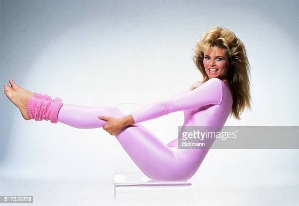 Christie Brinkley works out in a pink spandex unitard and leg warmers