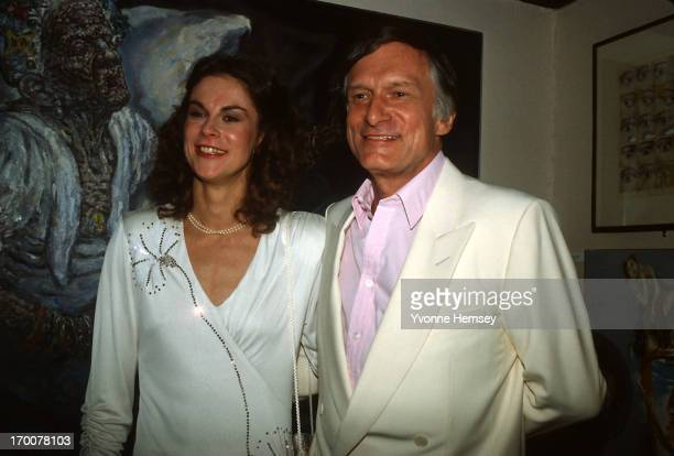 Christie Hefner and a male bunny are photographed October 29 1985 at the reopening of the Playboy club in New York City