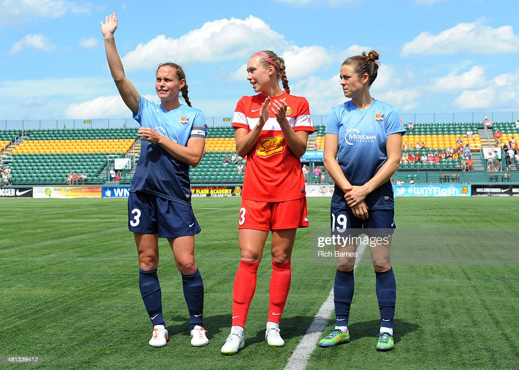 Christie Rampone #3 of Sky Blue FC waves to the crowd as Whitney Engen #3 of Western New York Flash and Kelley O'Hara #19 of Sky Blue FC look on during a pre-match ceremony to honor the members of the United States of America National Team playing in the match between the Sky Blue FC and the Western New York Flash at Sahlen's Stadium on July 19, 2015 in Rochester, New York. The Sky Blue FC and the Western New York Flash played to a 0-0 draw.