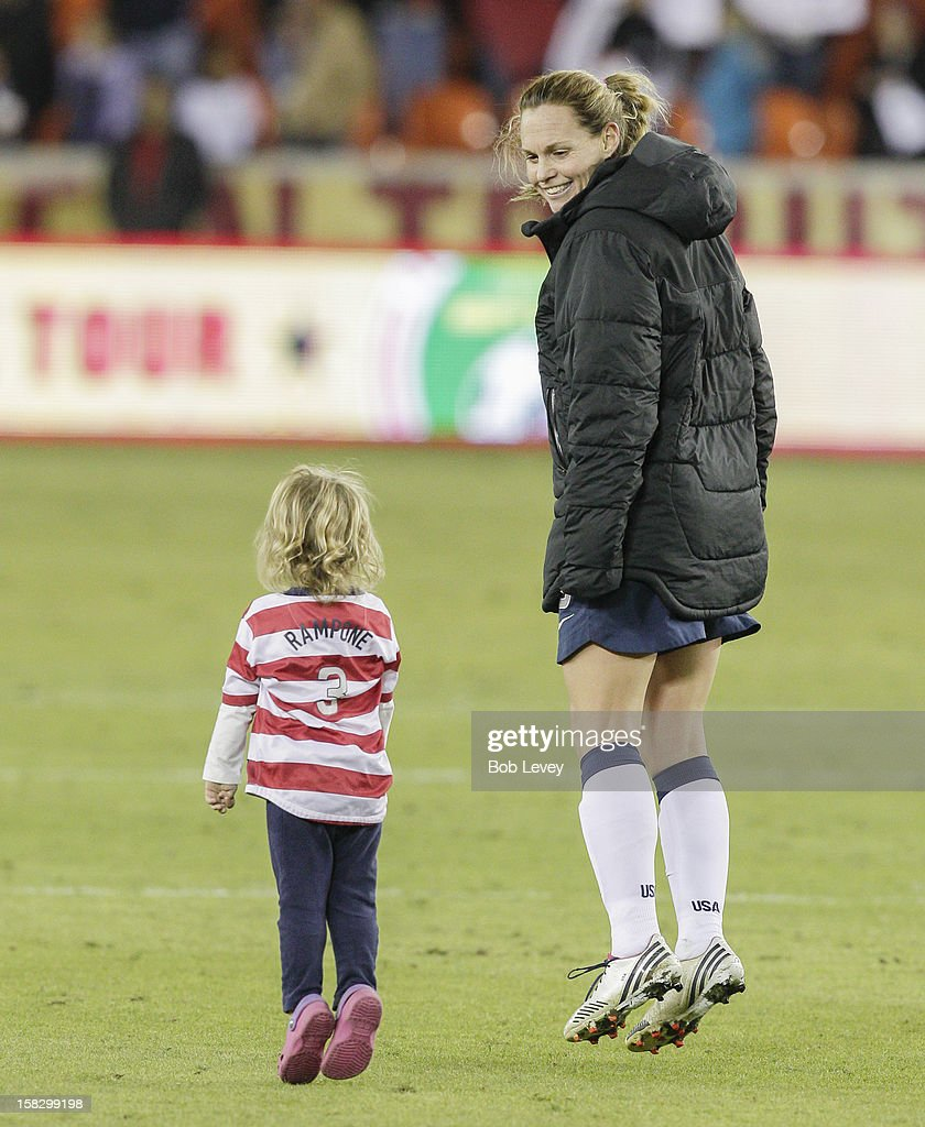 Christie Rampone (3) of the United States hops up and down with daughter, Reece Elizabeth up after defeating of China in the second half at BBVA Compass Stadium on December 12, 2012 in Houston, Texas. USA won 4-0.
