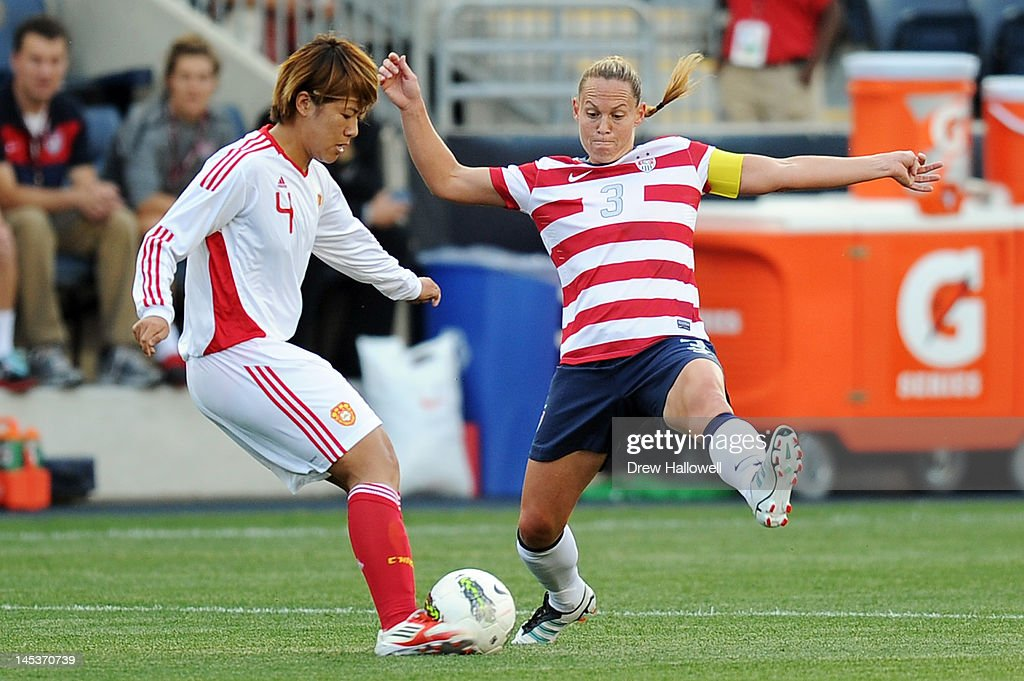 Christie Rampone #3 of the USA tries to block the kick of Li Jiayue #4 of the China at PPL Park on May 27, 2012 in Chester, Pennsylvania.