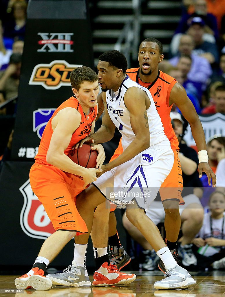 Christien Sager #15 of the Oklahoma State Cowboys fights for control of the ball against Shane Southwell #1 of the Kansas State Wildcats in the first half during the Semifinals of the Big 12 basketball tournament at the Sprint Center on March 15, 2013 in Kansas City, Missouri.