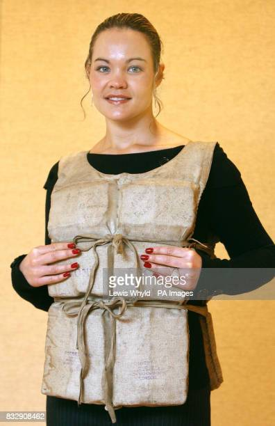 Christie's Ansie Els models the wears life preserver that was worn by Miss Mabel Francatelli who survived when the Titanic sank in 1912