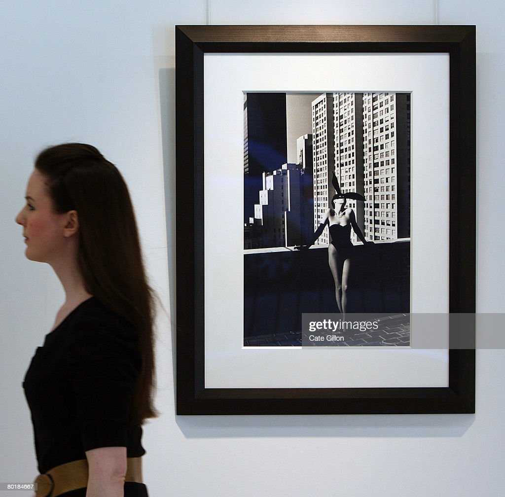 Christies' assistant passes 'Elsa Peretti as Bunnygirl New York 1975' by Helmut Newton on March 10 2008 in London England The Collection is owned by...