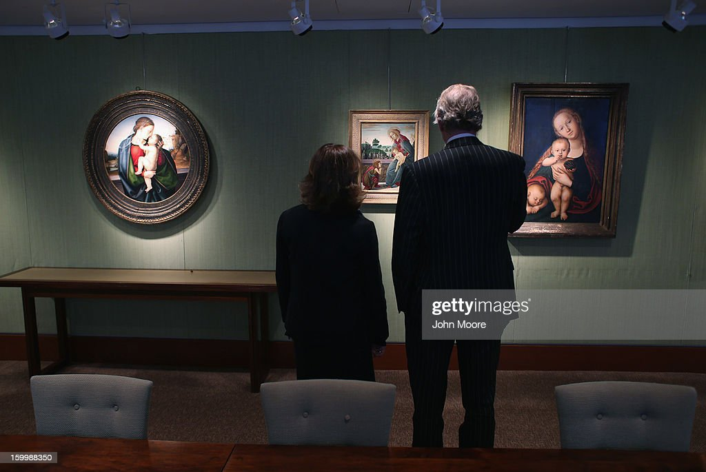 Christie's auction house employees stand in front of Renaissance paintings, including 'The Rockefeller Madonna' by Sandro Botticelli (C), on January 24, 2013 in New York City. The auction house previewed pieces from its upcoming Old Masters Week, to be held Jan. 26-31 in New York City, with the auction beginning January 29.