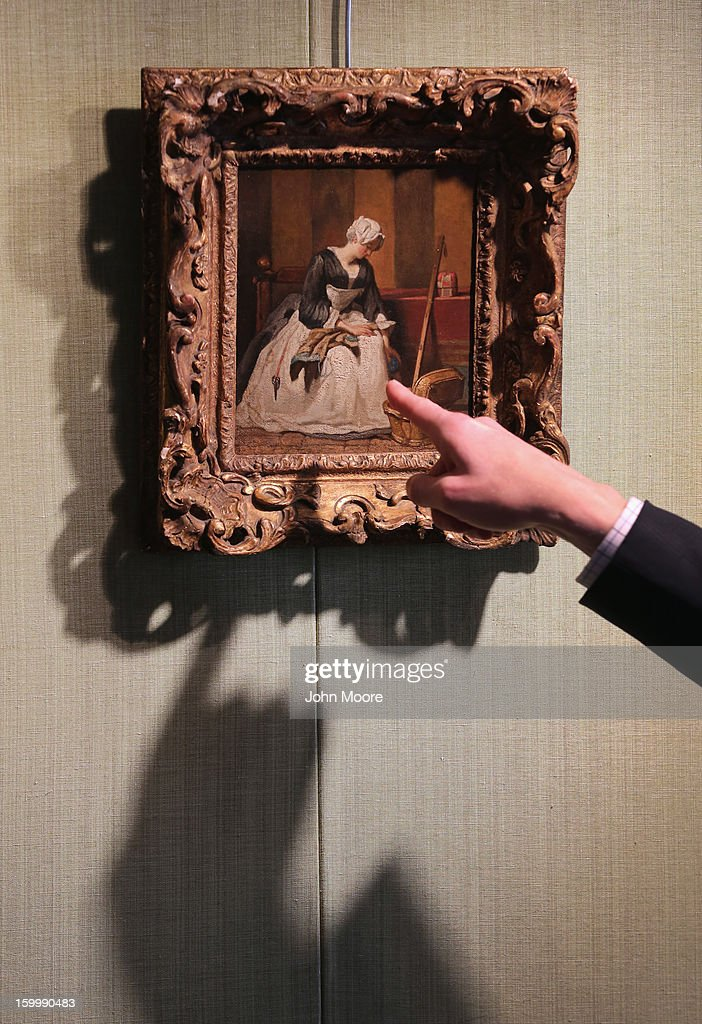 Christie's auction house head of sale Alan Wintermute describes Italian Renaissance painting 'The Embroiderer' by Jean-Baptiste-Simeon Chardin on January 24, 2013 in New York City. The painting, is expected to sell for $3-5 million. The auction house previewed pieces from its upcoming Old Masters Week, to be held Jan. 26-31 in New York City, with the auction beginning January 29.