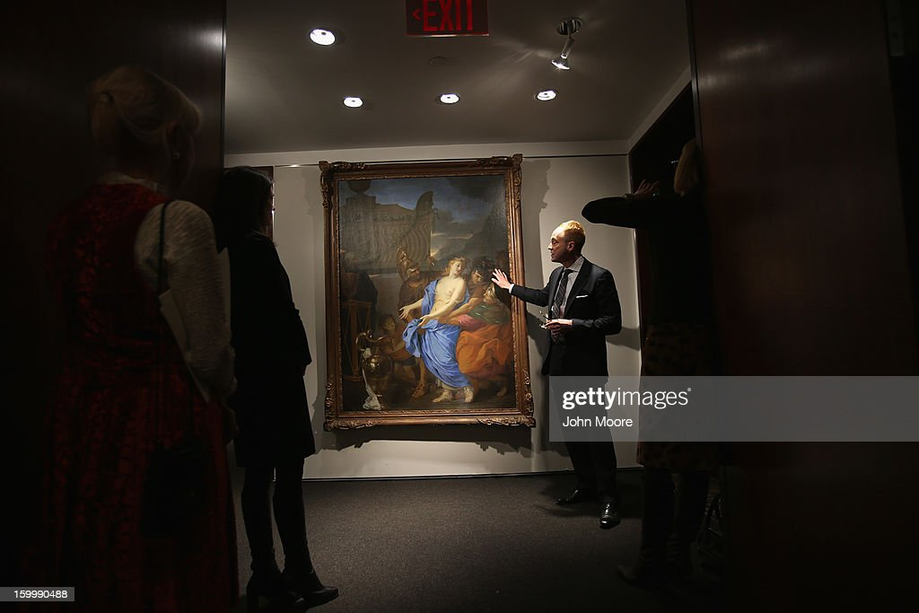 Christie's auction house head of sale Alan Wintermute describes Renaissance painting 'The Sacrifice of Polyxena' by Charles Le Brun on January 24, 2013 in New York City. The painting, which was recently discovered hanging on a wall in the Hotel Ritz in Paris, is expected to sell for more than half a million dollars. The auction house previewed pieces from its upcoming Old Masters Week, to be held Jan. 26-31 in New York City, with the auction beginning January 29.