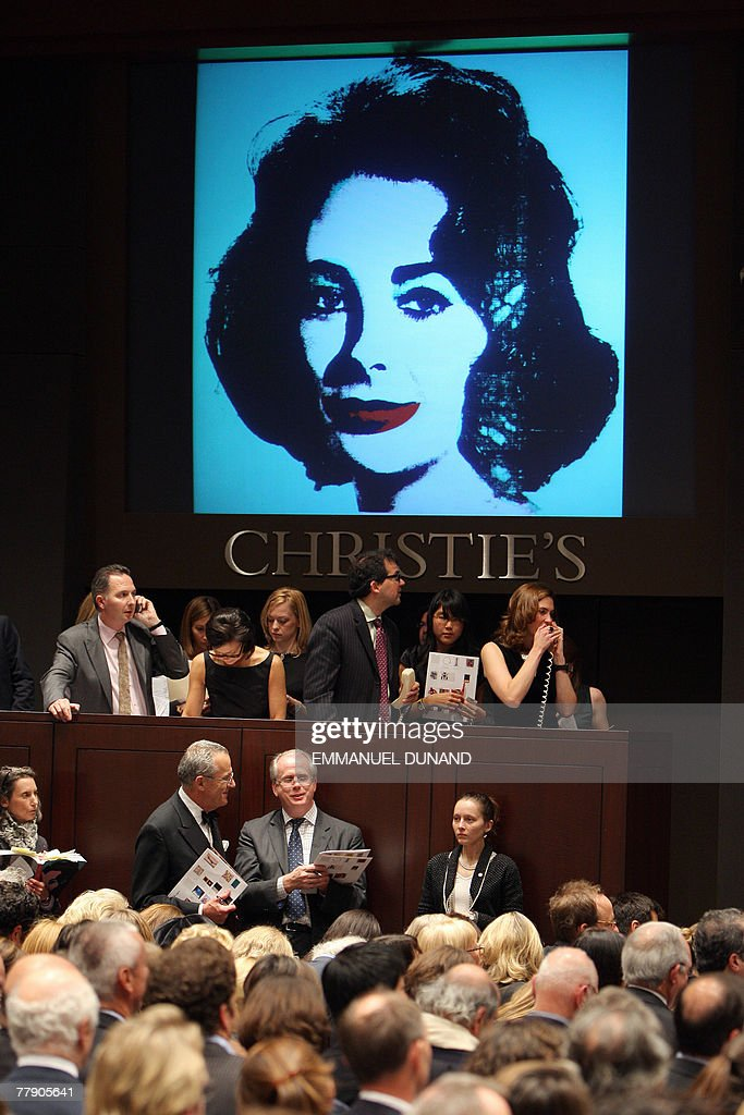 Christie's auction house staff receive telephone bids for 'Liz' by artist Andy Warhol during Christie's bi-annual Post-War and Contemporary Art Sale in New York, 13 November 2007. The painting sold for 23.5 million USD after premium, while the work had been estimated to sell for 25-35 million USD. Christie's sale reached a total of 325 million USD from an estimate of 242 to 338 million USD. AFP PHOTO/Emmanuel DUNAND
