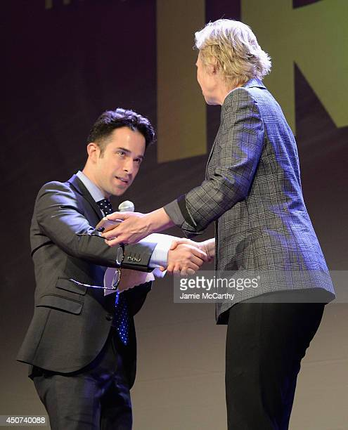 Christie's Auctioneer Seth Watsky and Jane Lynch speak onstage at the Trevor Project's 2014 'TrevorLIVE NY' Event at the Marriott Marquis Hotel on...
