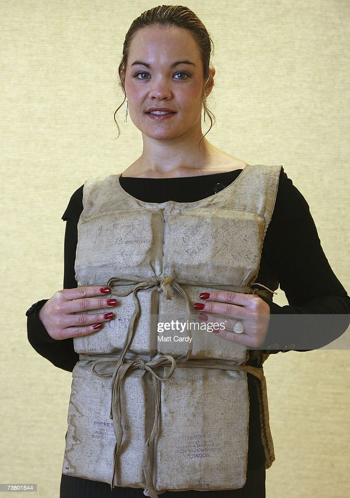 Christies employee Ansie Els wears a Titanic life-preserver, which was worn by Titanic survivor Miss Mabel Francatelli, on April 4 2007 in London. The life-preserver is part of a Maritime sale of memorabilia from the 1912 disaster and is estimated to sale for 50,000 to 80,000 pounds.