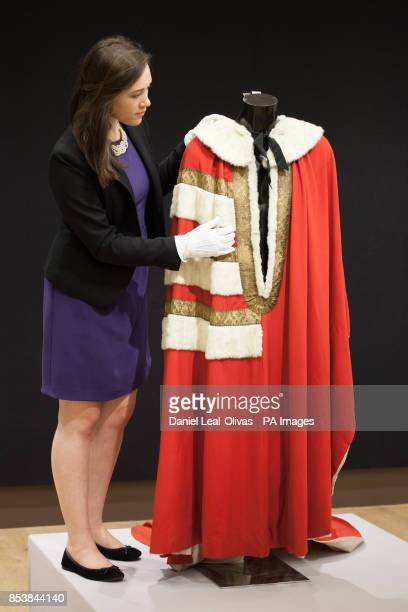 A Christie's employee arranges Lord Lucan's parliamentary robe which is part of the Famous and Infamous exhibition which includes highlights from the...
