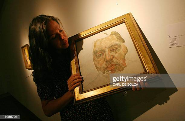 A Christie's employee looks at a portrait of Francis Bacon by British artist Lucian Freud at Christie's auction house in London on October 14 2008...