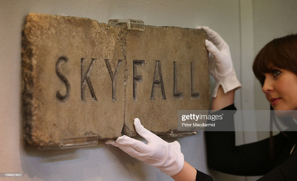 A Christie's employee looks at a replica fibreglass SKYFALL sign on November 23, 2012 in London, England. Estimated at £1000 - £1500 it forms part of Christie's Pop Culture sale on November 29 in London.