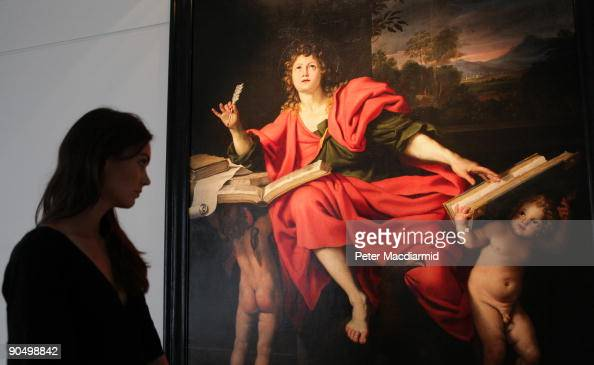 Christie's employee looks at Domenico Zampieri's Saint John The Evangelist painting on September 9 2009 in London England Christie's estimate that...