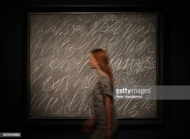 Christie's employee passes Cy Twombly's 'Untitled ' on February 6 2015 in London England Estimated in the region of £15 million the work forms part...