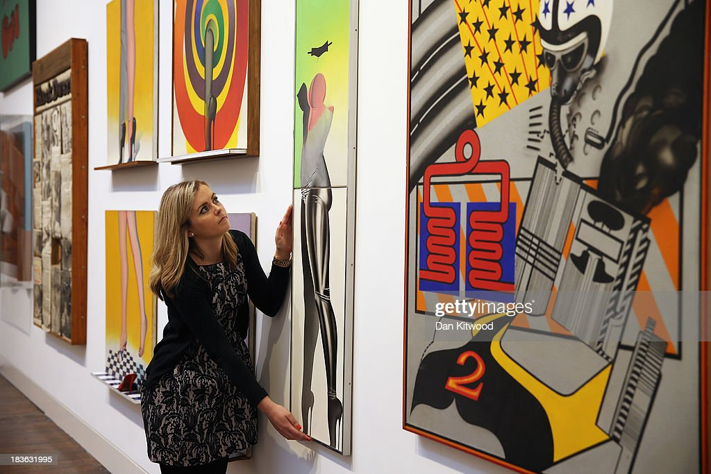 A Christie's employee poses besides a piece of work entitled 'First Step' by Allen Jones during the 'When Britain went Pop!' exhibition at Christie's auction house on October 8, 2013 in London, England. The exhibition claims to be 'the first ever Comprehensive exhibition of British Pop Art to be held in London' and includes work by artists including David Hockney, Peter Blake, Richard Hamilton and Allen Jones and opens to the public until November 23.