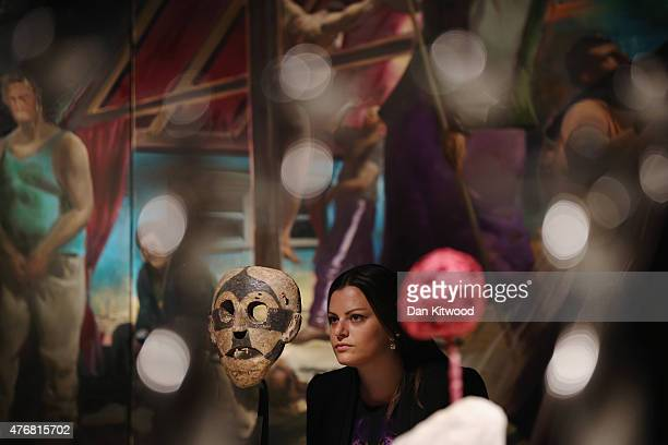 Christie's employee poses next to a Boa Mask during a photocall at Christie's Auction House on June 12 2015 in London England The item makes up part...