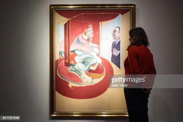 Christie's employee poses with Study of a Red Pope 1962 2nd Version 1971 by Francis Bacon at Christie's on September 15 2017 in London England The...
