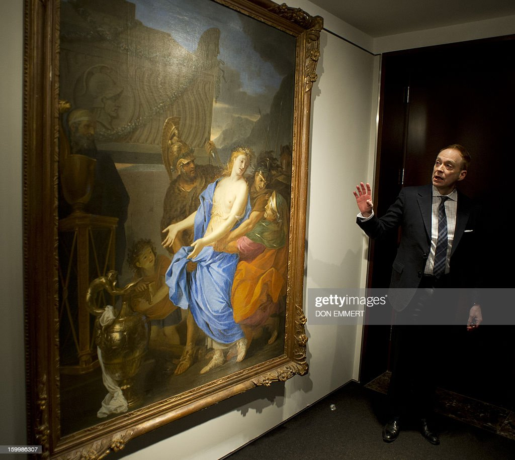 A Christie's employee speaks about 'The Sacrifice of Polyxena' by Charles Le Brun January 24, 2013 at Christie's in New York. The painting is one of the works scheduled to be auctioned during the Old Masters and 19th Century Art Auction April 15, 2013 in Paris.
