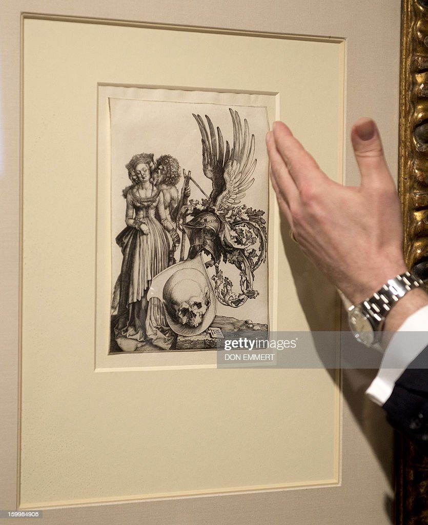 A Christie's employee talks about 'Coat of Arms with a Skull' by Albrecht Durer January 24, 2013 at Christie's in New York. The etching is one of the works scheduled to be auctioned during Old Masters week January 26-31, 2013.