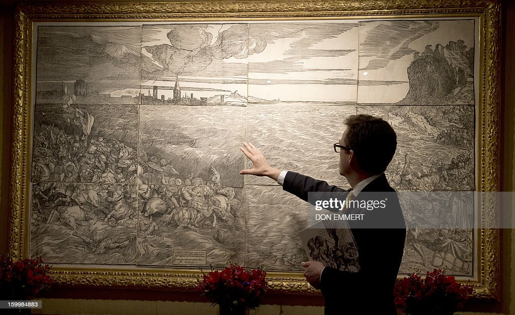 A Christie's employee talks about 'The Landscape with the Cannon' by Albrecht Durer January 24, 2013 at Christie's in New York. The etching is one of the works scheduled to be auctioned during Old Masters week January 26-31, 2013. AFP PHOTO/DON EMMERT