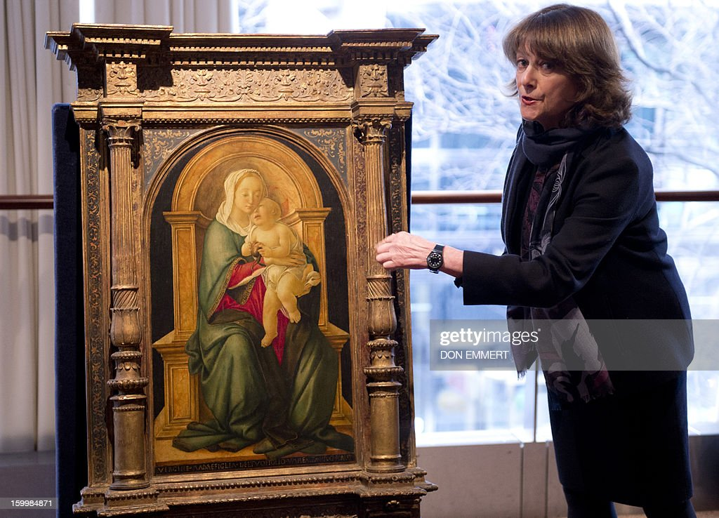 A Christie's employee talks about 'The Madonna and Child with a Pomegranate' by Sandro Botticelli January 24, 2013 at Christie's in New York. The painting is one of the works scheduled to be auctioned during Old Masters week January 26-31, 2013.
