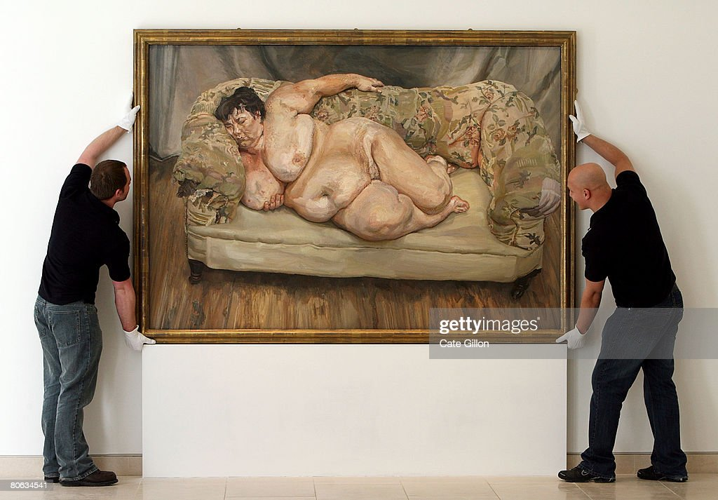Christies' employees hang Lucian Freud's painting 'Benefits Supervisor Sleeping, 1995' on April 11, 2008 in London, England. The life-size 'Benefits Supervisor Sleeping, 1995' painting shows a naked Sue Tilley from London and is estimated to fetch between 25 to 35 million USD which would make it the most expensive auctioned artwork.
