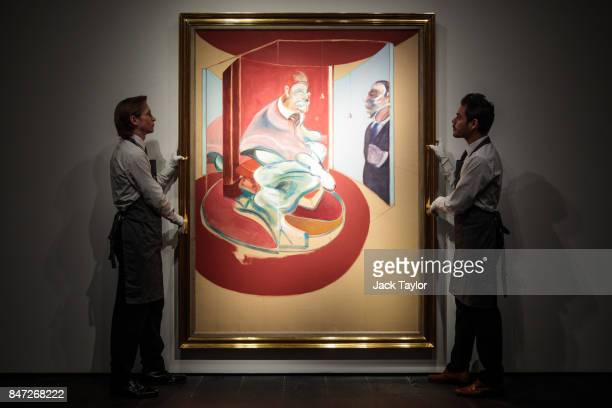 Christie's employees pose with Study of a Red Pope 1962 2nd Version 1971 by Francis Bacon at Christie's on September 15 2017 in London England The...
