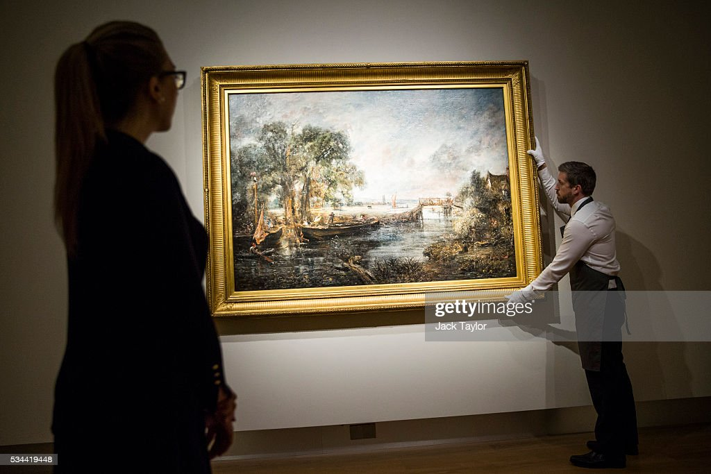 Christie's employees pose with 'View on the River Stour near Dedham' circa 1821-1822 by English painter John Constable at the auction house on May 26, 2016 in London, England. The full-scale six-foot 'sketch' will be offered in Christie's 250th anniversary 'Defining British Art' sale and has an estimate in the region of £12-16 million.