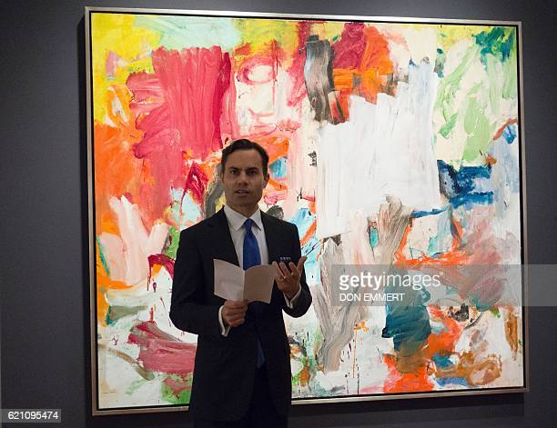 A Christie's official speaks in front of 'Untitled XXV' by Willem de Kooning November 4 2016 in New York during a press preview The oil on canvas is...
