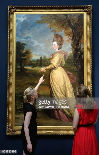 Christie's staff look at a portrait of Lady Frances Marsham by Sir Joshua Reynolds which will be auctioned as part of the Old Master British...