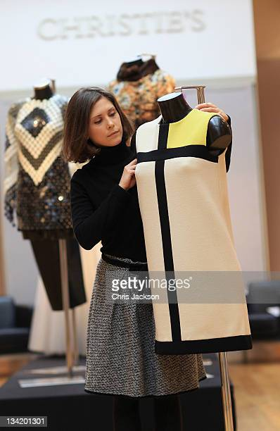 Christie's worker arranges a Yves Saint Laurent 'Mondrian' dress expected to fetch 25000 GBP as part of the Ultimate Fashion Exhibition at Christie's...