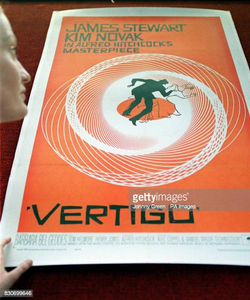 Christie's worker Rachel Dewhurst by the Saul Bass poster for the film Vertigo part of the sale of the Vintage Film Posters at Christie's South...