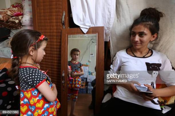 Christina a sixyearold Iraqi Christian girl meets with her family in Ashti 2 camp for displaced Christians in Arbil the capital of the autonomous...