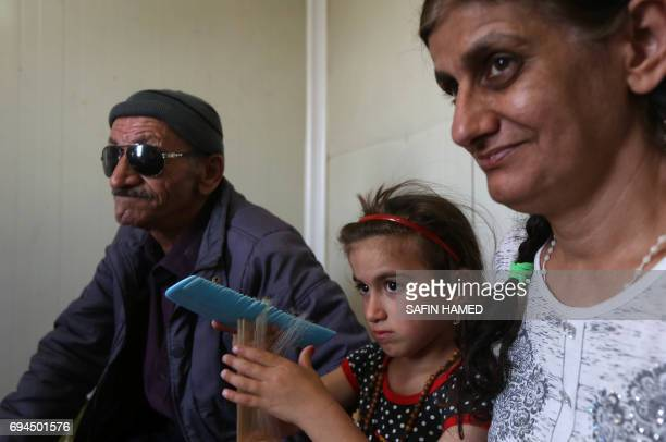 Christina a sixyearold Iraqi Christian girl meets with her father and mother in Ashti 2 camp for displaced Christians in Arbil the capital of the...