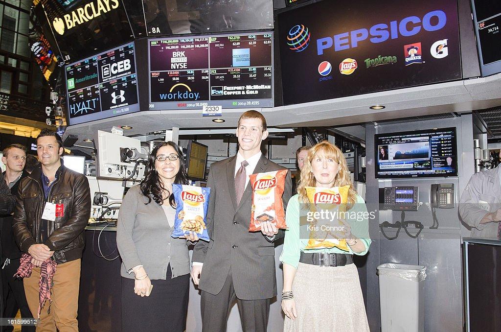 Christina Abu-Judom, , Tyler Raineri and Karen Weber-Mendham pose for a photo during the NYSE Celebrates Lay's 'Do Us a Flavor' Contest Finalists during the opening bell at New York Stock Exchange on February 12, 2013 in New York City.