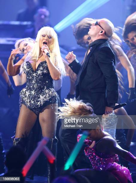 Christina Aguilera and Pitbull perform onstage at The 40th American Music Awards held at Nokia Theatre LA Live on November 18 2012 in Los Angeles...