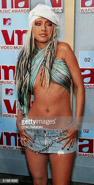 Christina Aguilera arrives at the MTV Video Music Awards 29 August 2002 in New York Aquilera will be a presenter at the event AFP PHOTO/DON EMMERT