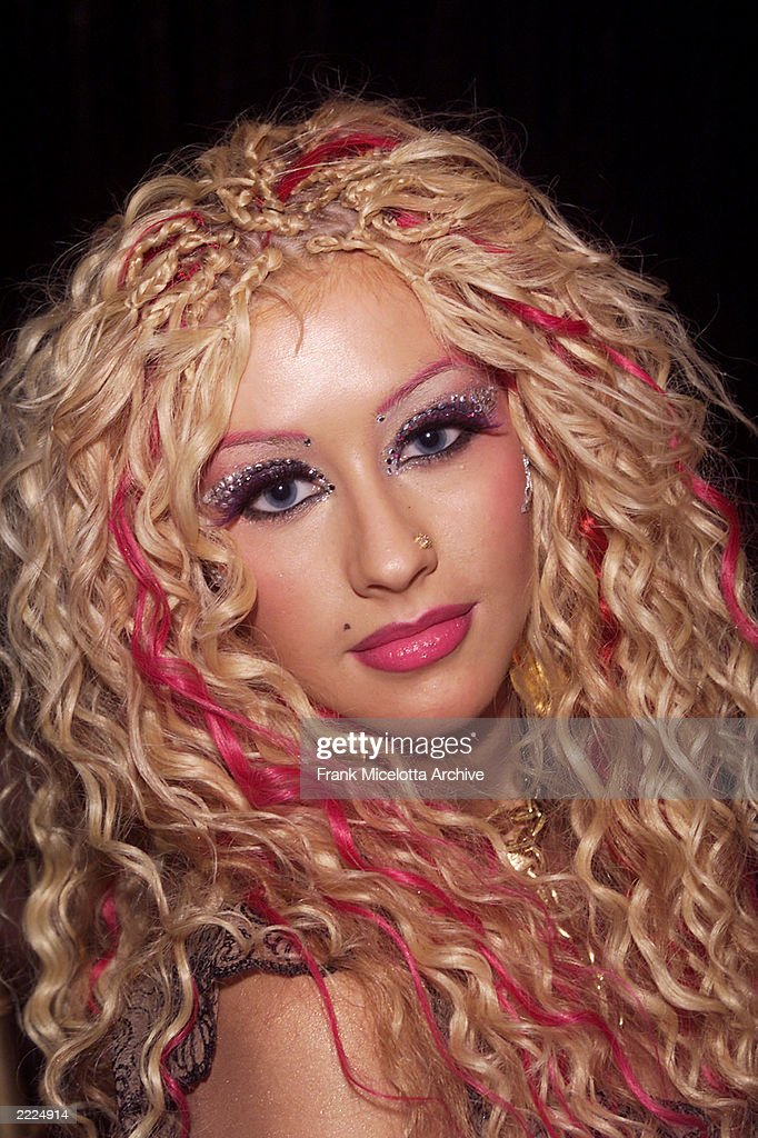 <a gi-track='captionPersonalityLinkClicked' href=/galleries/search?phrase=Christina+Aguilera&family=editorial&specificpeople=171272 ng-click='$event.stopPropagation()'>Christina Aguilera</a> at the MTV 2001 Movie Awards at the Shrine Auditorium in Los Angeles, Ca., 6/2/01. Photo by Frank Micelotta/ImageDirect.