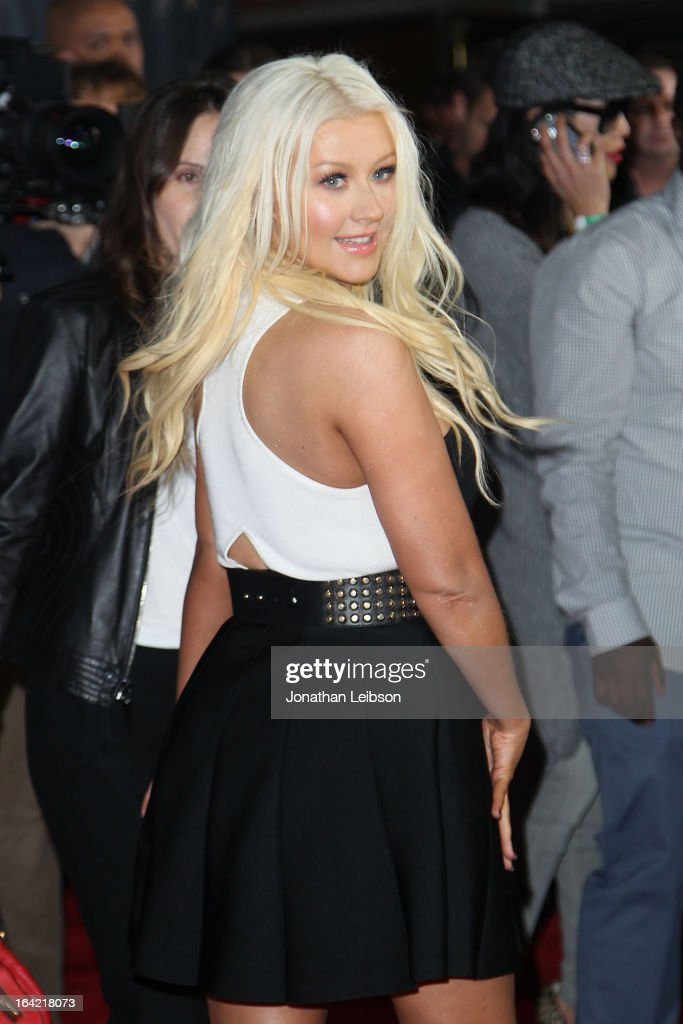 <a gi-track='captionPersonalityLinkClicked' href=/galleries/search?phrase=Christina+Aguilera&family=editorial&specificpeople=171272 ng-click='$event.stopPropagation()'>Christina Aguilera</a> attends the NBC's 'The Voice' Season 4 Premiere at TCL Chinese Theatre on March 20, 2013 in Hollywood, California.