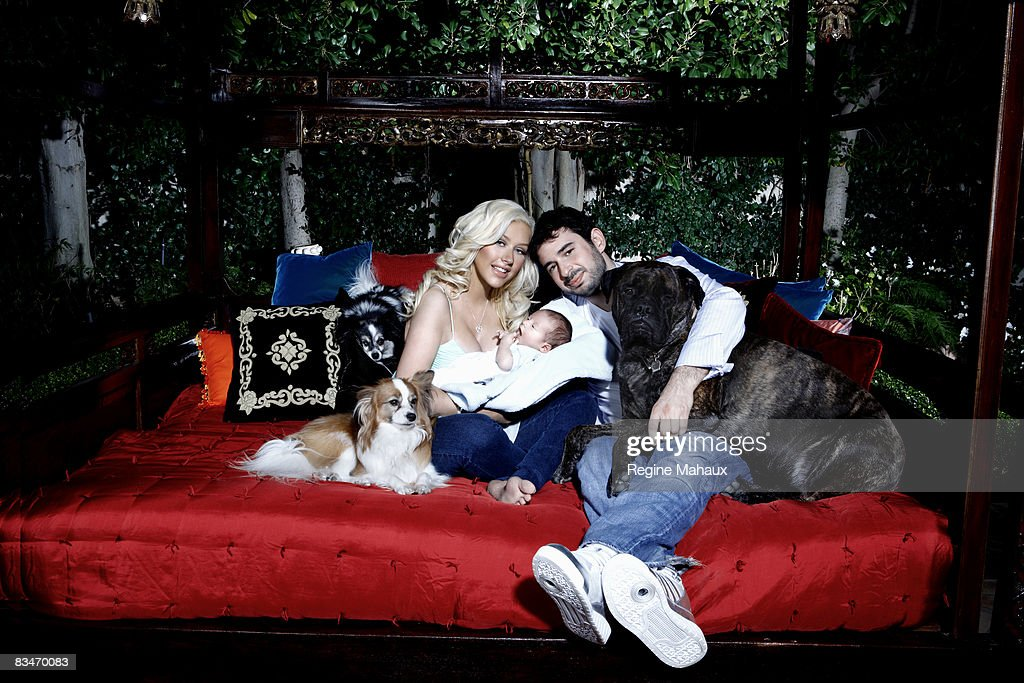 Christina Aguilera poses with her husband Jordan Bratman and their son Max Liron Bratman on February 9, 2008 in their Los Angeles, California home.