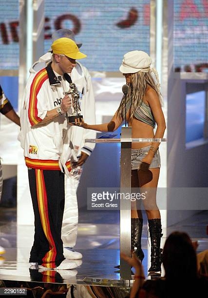 Christina Aguilera presents an award to Eminem at the 2002 MTV Video Music Awards at Radio City Music Hall in New York City August 29 2002 Photo by...